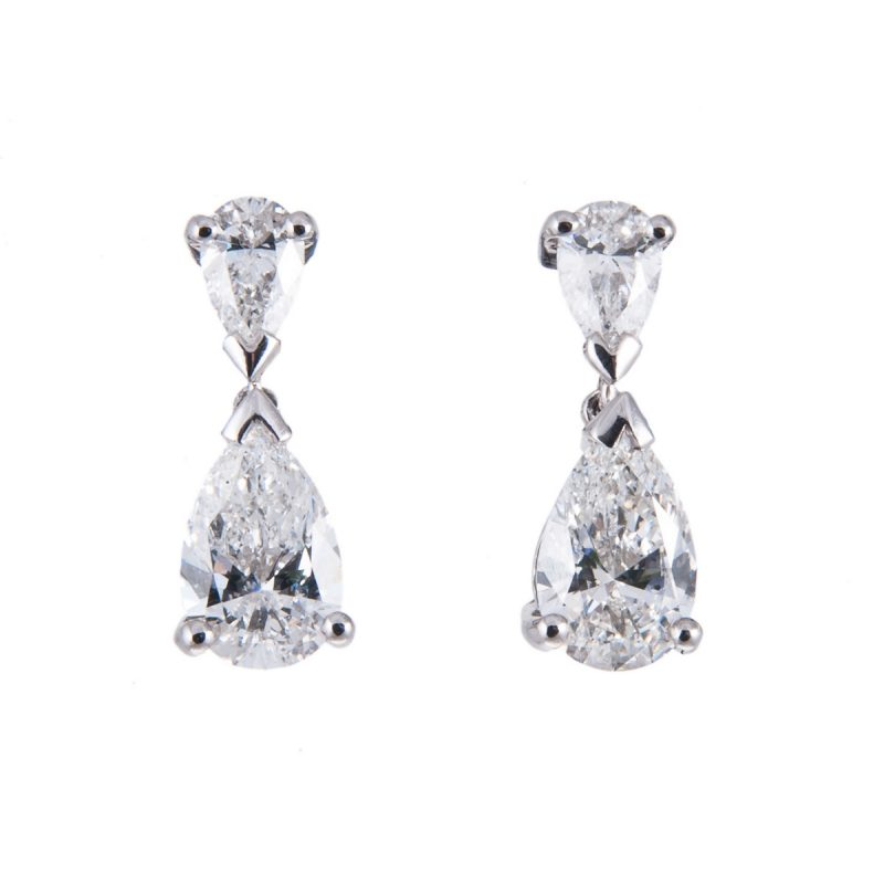 platinum pear shaped diamond drop earrings in a claw setting