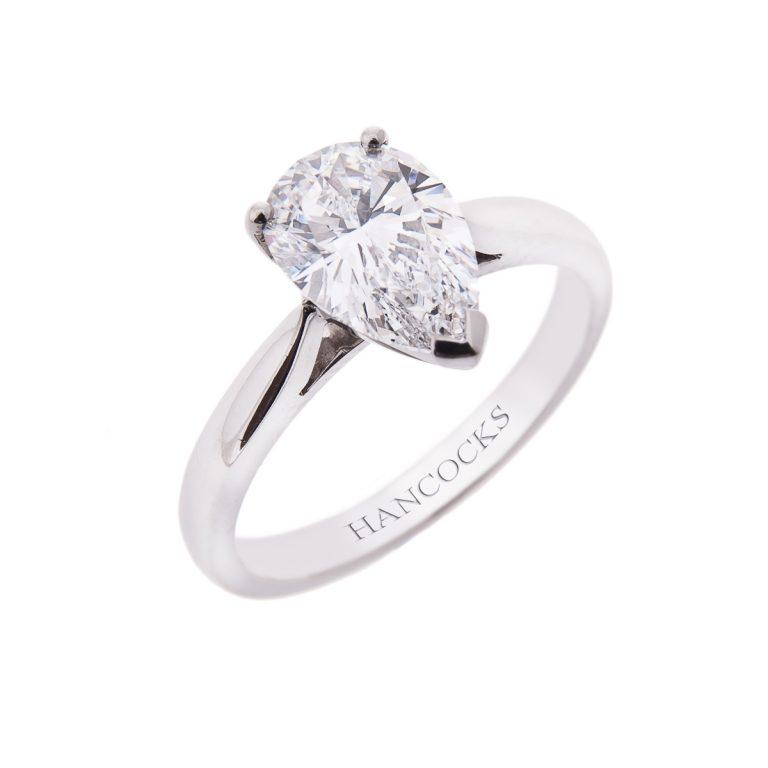 certificated pear cut diamond engagement ring in platinum