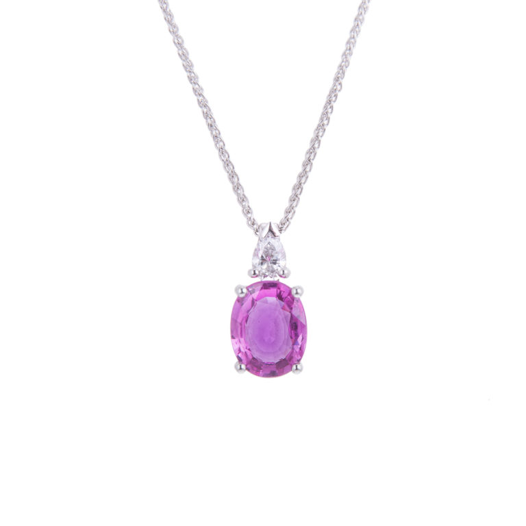 oval pink sapphire pendant with pear cut diamond detail