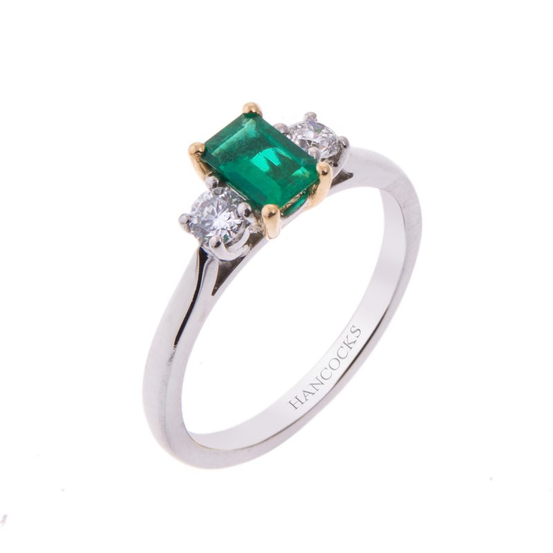 platinum emerald and diamond 3-stone claw set engagement ring