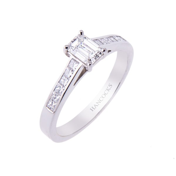 platinum-emerald-cut-diamond-solitaire-with-princess-cut-diamond-shoulders