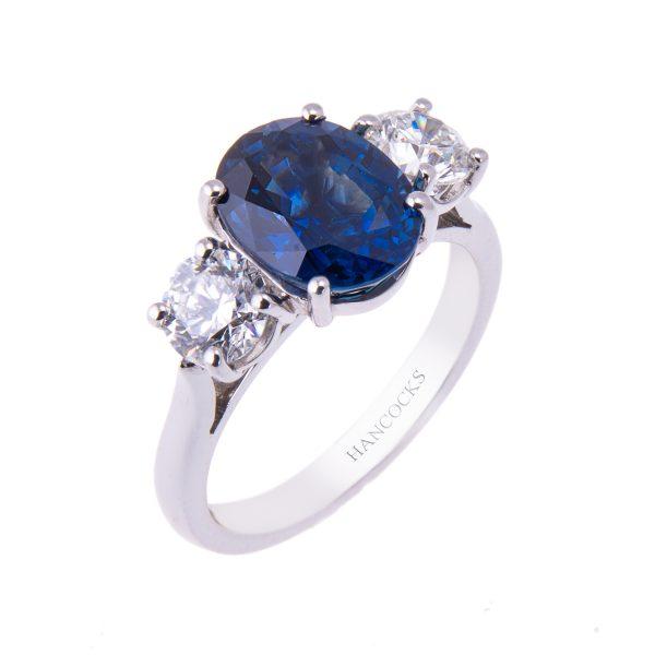 platinum-claw-set-sapphire-and-diamond-engagement-ring