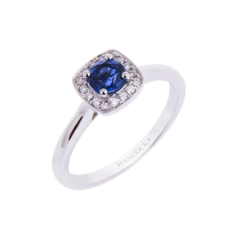 platinum sapphire and diamond halo set cluster engagement ring