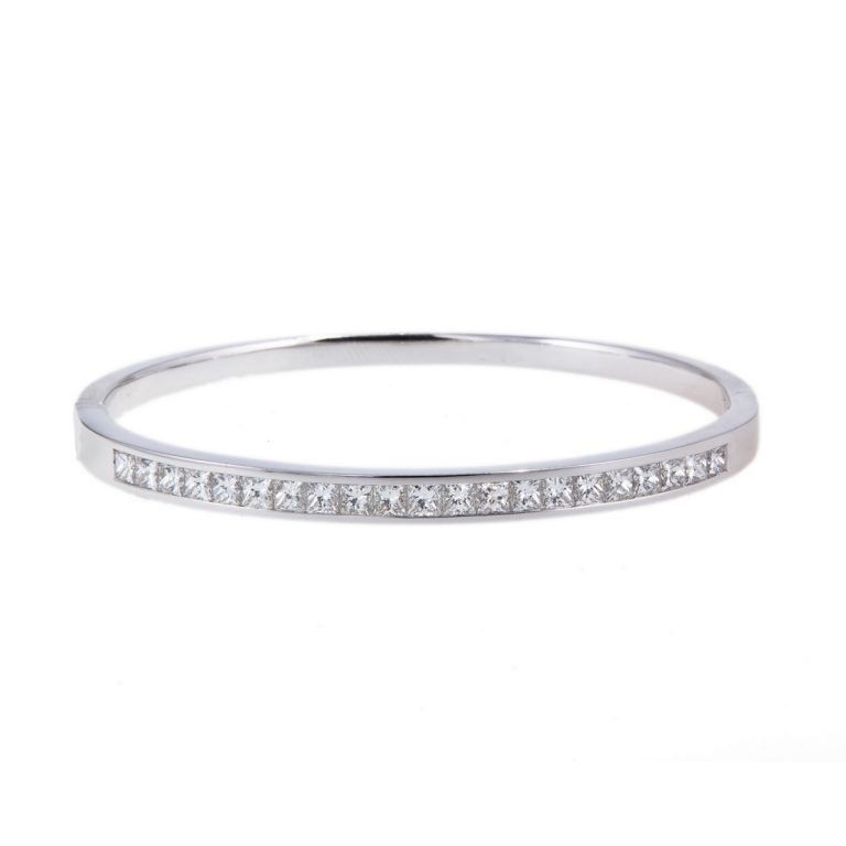 channel set princess cut diamond bangle in 18ct gold
