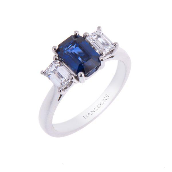 emerald cut sapphire and diamond 3-stone ring in platinum