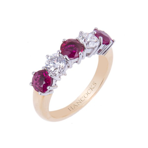ruby and diamond half eternity in a classic claw setting
