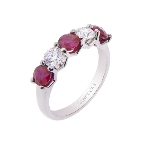 platinum claw set ruby and diamond five stone half eternity ring