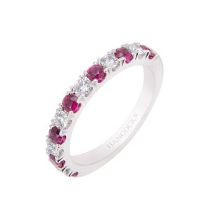 ruby and brilliant cut diamond castle set half eternity ring
