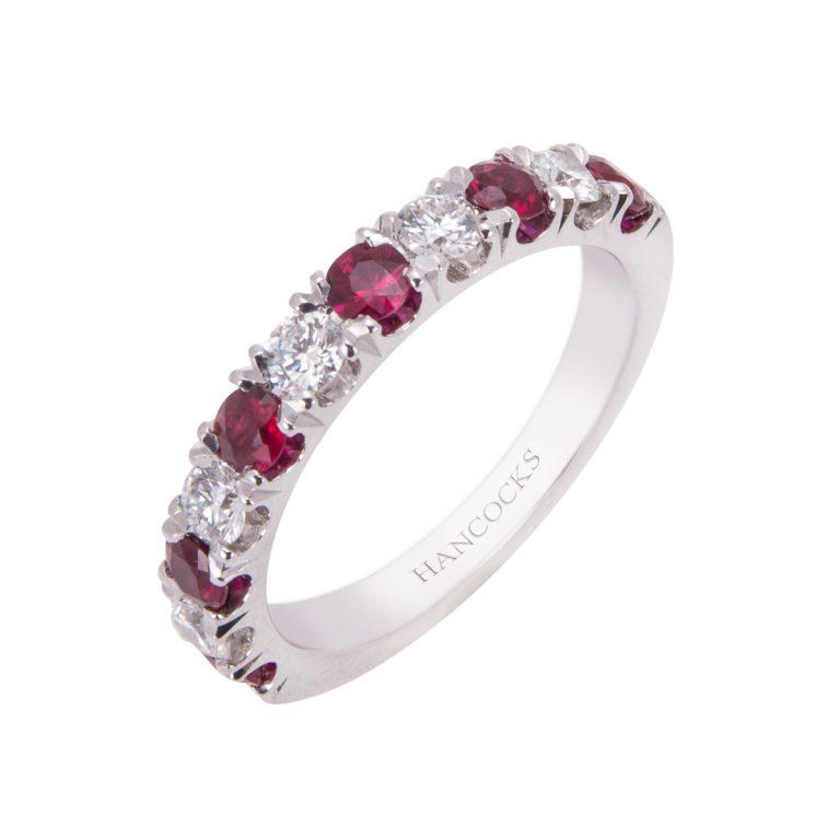ruby and brilliant cut diamond castle set platinum half eternity ring