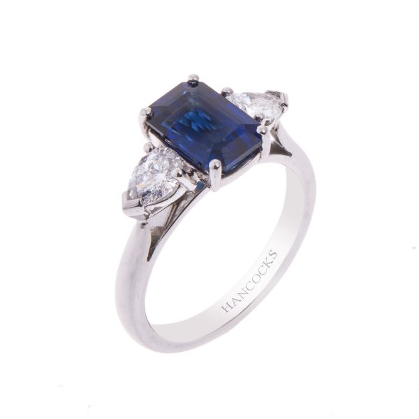 emerald cut sapphire and pear cut diamond trilogy engagement ring