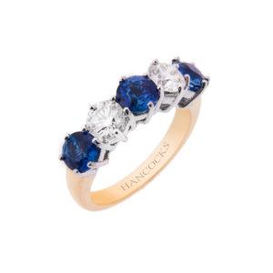 18ct gold sapphire and brilliant cut diamond half eternity ring