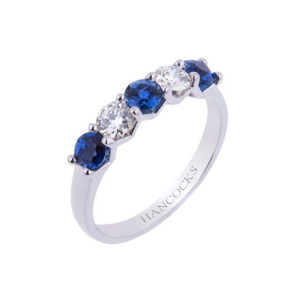 platinum claw set sapphire and diamond half eternity ring