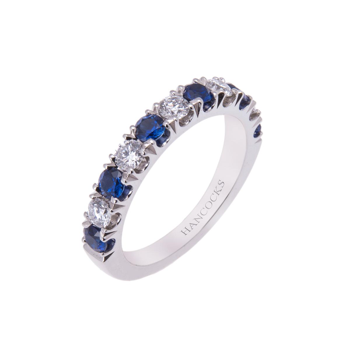platinum-claw-set-sapphire-and-diamond-eternity-ring