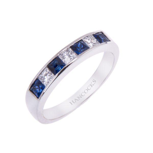 platinum channel set sapphire and diamond half eternity ring