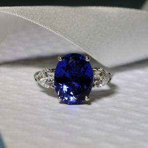 oval-tanzanite-and-diamond-3-stone-ring