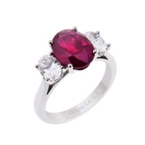 oval ruby and diamond three stone ring set in platinum