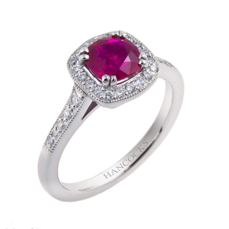 platinum cushion cut ruby ring with diamond set halo surround and shank